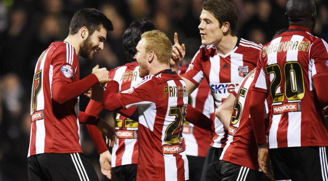 Brentford players celebrate during their victory over Blackpool