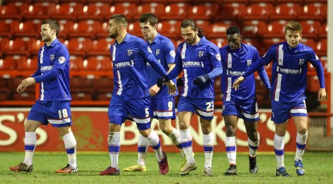 Gillingham players celebrate scoring