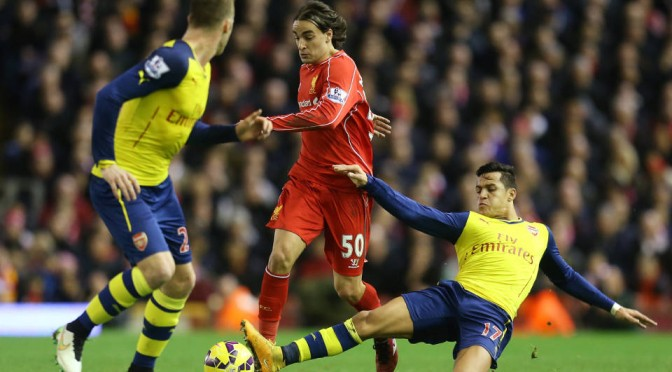 Liverpool's Lazar Markovic takens on Alexis Sanchez and Calum Chambers of Arsenal