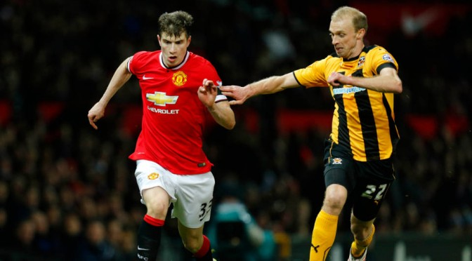 Paddy McNair takes on Luke Chadwick