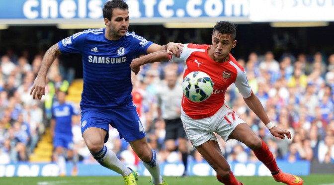 Chelsea's Cesc Fabregas tries to tackle Arsenal's Alexis Sanchez