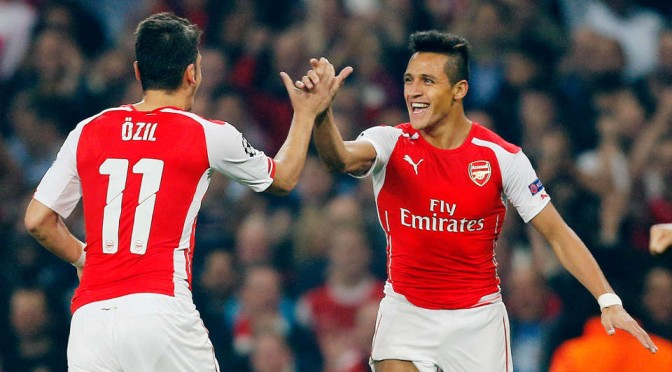 Mesut Ozil and Alexis Sanchez celebrate for Arsenal