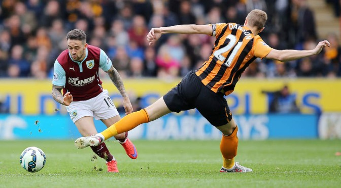 Burnley's Danny Ings takes on Hull City's Michael Dawson