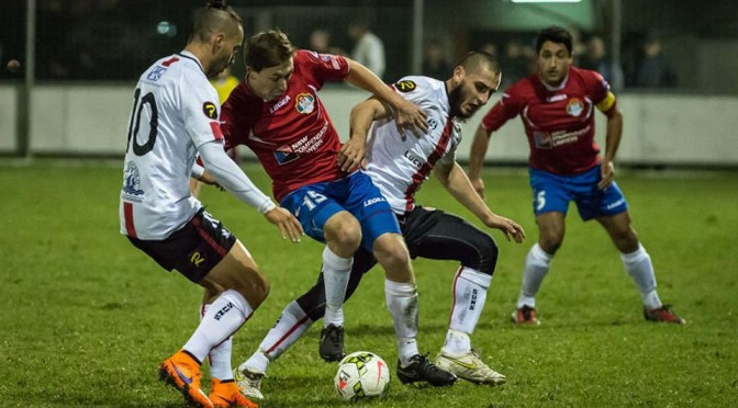 Photo: Bonnyrigg's Ray Miller (number 15) is crowded by two Rockdale City players. Rockdale won this NSW Premier One match 3:0. Photo credit to loopi – Football NSW
