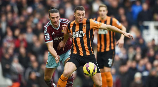 New West Brom signing James Chester fights off Andy Carroll to win the ball